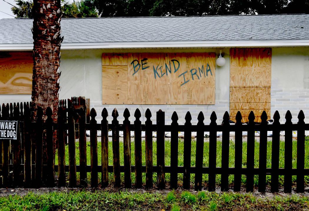 A homeowner in Bonita Springs, Florida, makes a plea to Hurricane Irma. (Michael S. Williamson/Washington Post)