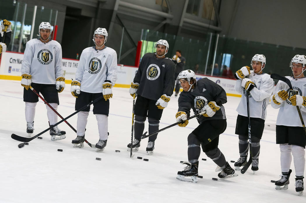 Vegas Golden Knights forward Tyler Wong, third from right,  shoots on goalie Logan Thompson during the final day of rookie camp practice at City National Arena on Monday, Sept. 11, 2017, in Las Ve ...