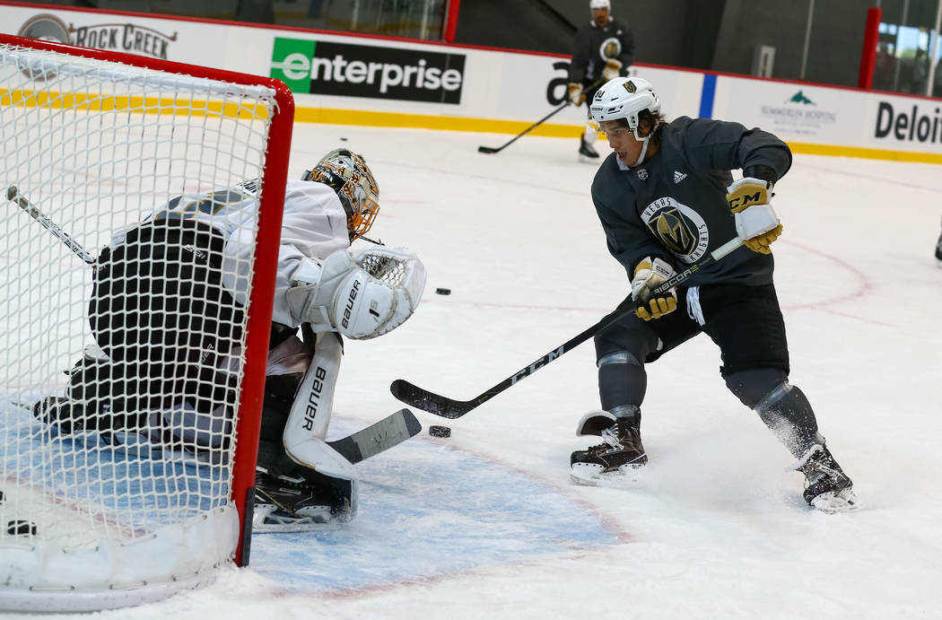 Vegas Golden Knights forward Tyler Wong, right, shoots on goalie Logan Thompson during the final day of rookie camp practice at City National Arena on Monday, Sept. 11, 2017, in Las Vegas. Richard ...