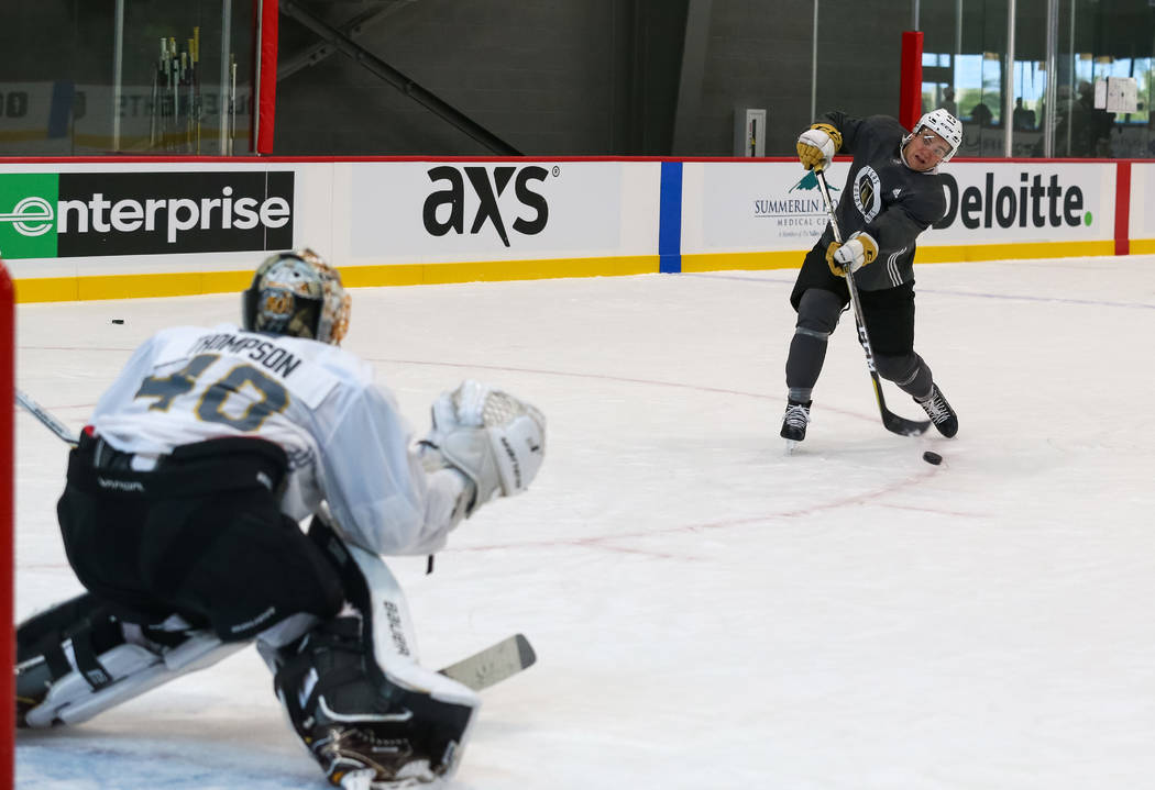 Vegas Golden Knights defender Jake Bischoff, right,  shoots on goalie Logan Thompson during the final day of rookie camp practice at City National Arena on Monday, Sept. 11, 2017, in Las Vegas. Ri ...