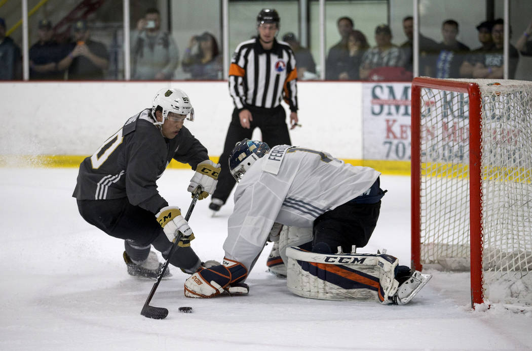 Tyler Wong, left, shoots on goalie Dylan Ferguson during the Vegas Golden Knights Development Camp at the Las Vegas Ice Center in Las Vegas on Saturday, July 1, 2017. Richard Brian Las Vegas Revie ...