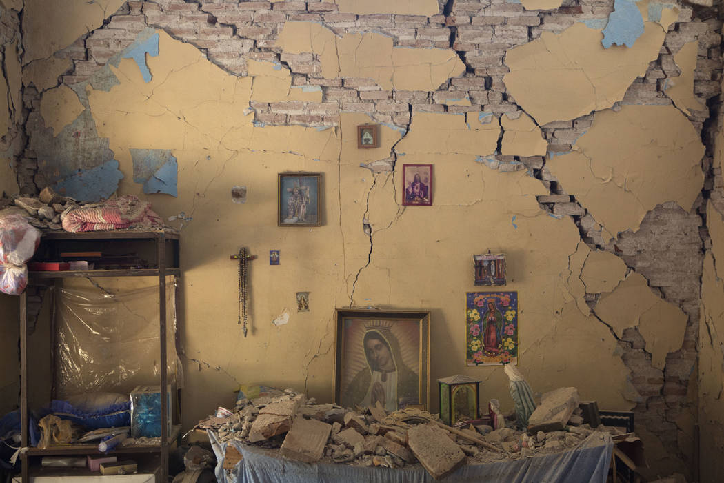 An altar to the Virgin of Guadalupe is covered with fallen debris inside the earth-damaged home where Larissa Garcia, 24, lived with her family in Juchitan, Oaxaca state, Mexico, Saturday, Sept. 9 ...