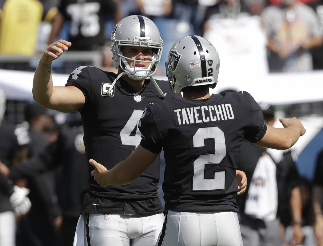 Oakland Raiders kicker Giorgio Tavecchio (2) celebrates with quarterback Derek Carr (4) after Tavecchio kicked a a 43-yard field goal against the Tennessee Titans in the fourth quarter of an NFL f ...