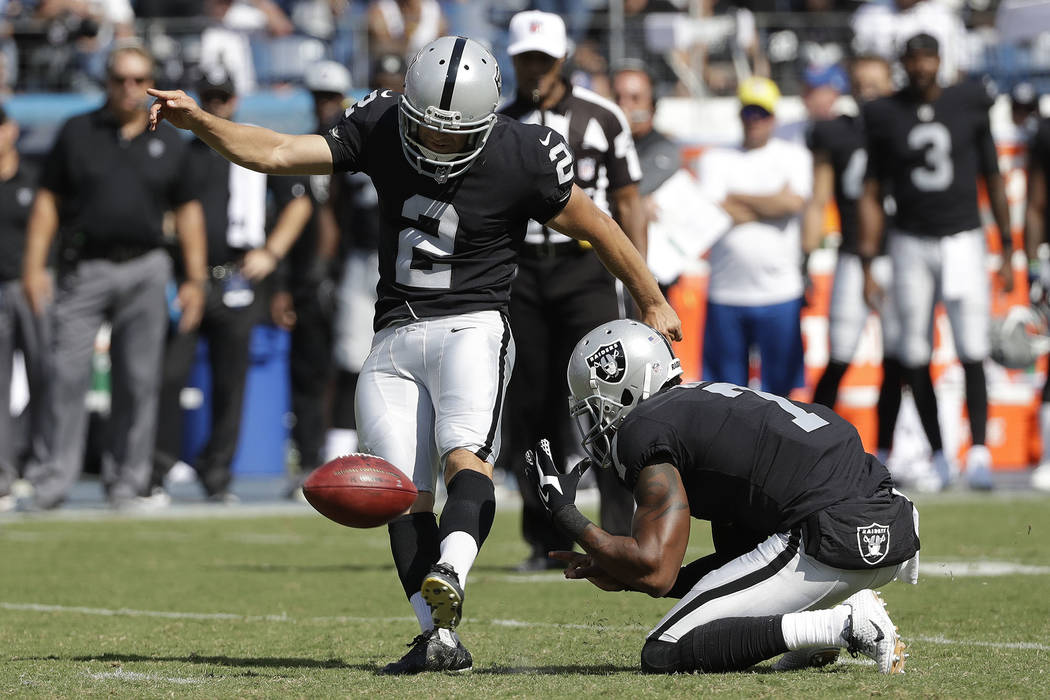 Oakland Raiders kicker Giorgio Tavecchio (2) kicks a 43-yard field goal as Marquette King (7) holds against the Tennessee Titans in the second half of an NFL football game Sunday, Sept. 10, 2017,  ...