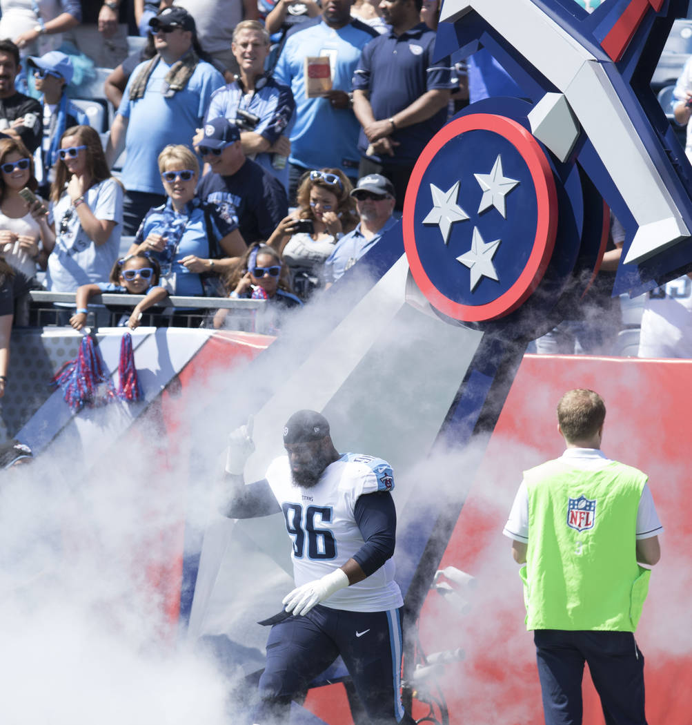 Tennessee Titans defensive tackle Sylvester Williams (96) comes on to the Nissan Stadium field for their game against the Oakland Raiders in Nashville, Tenn., Sunday, Sept. 10, 2017. Heidi Fang La ...