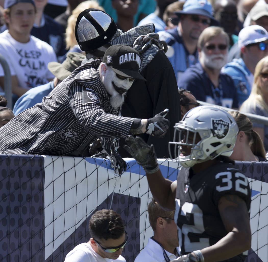 Oakland Raiders defensive back Antonio Hamilton (32) high fives a fan after the team scored in the first quarter against the Tennessee Titans at the Nissan Stadium in Nashville, Tenn., Sunday, Sep ...