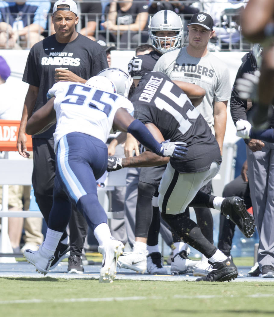 Oakland Raiders wide receiver Michael Crabtree (15) catches a pass over Tennessee Titans linebacker Jayon Brown (55) in the first half of the NFL game at the Nissan Stadium in Nashville, Tenn., Su ...