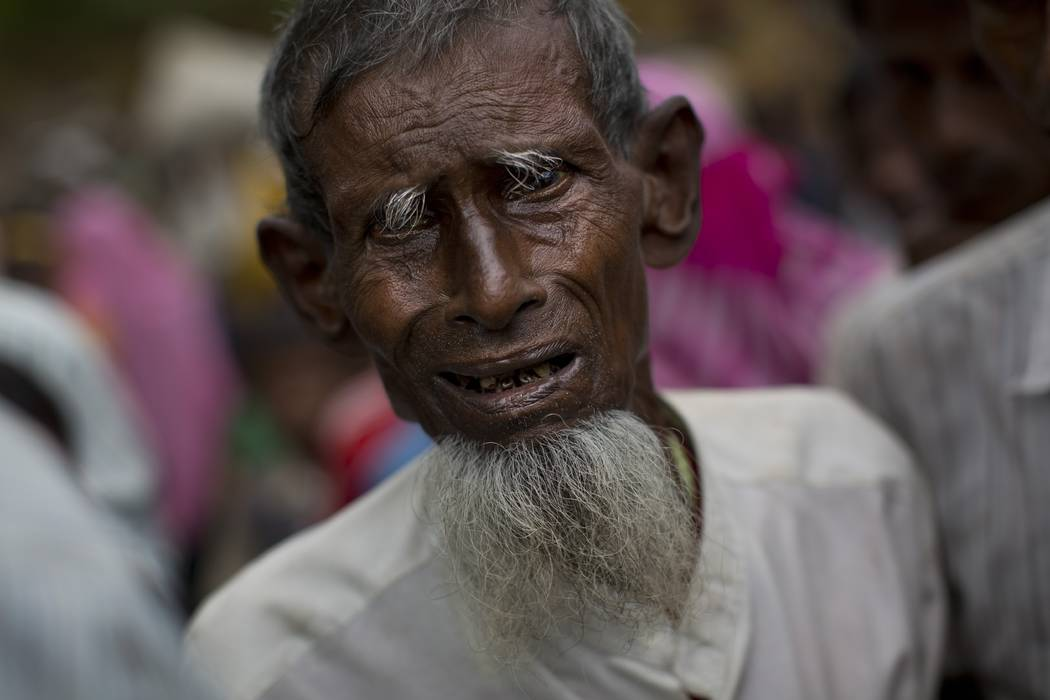 An elderly Rohingya Muslim, who recently crossed over from Myanmar into Bangladesh, arrives at a food distribution center in Kutupalong, Bangladesh, Saturday, Sept. 9, 2017. The U.N. said Saturday ...