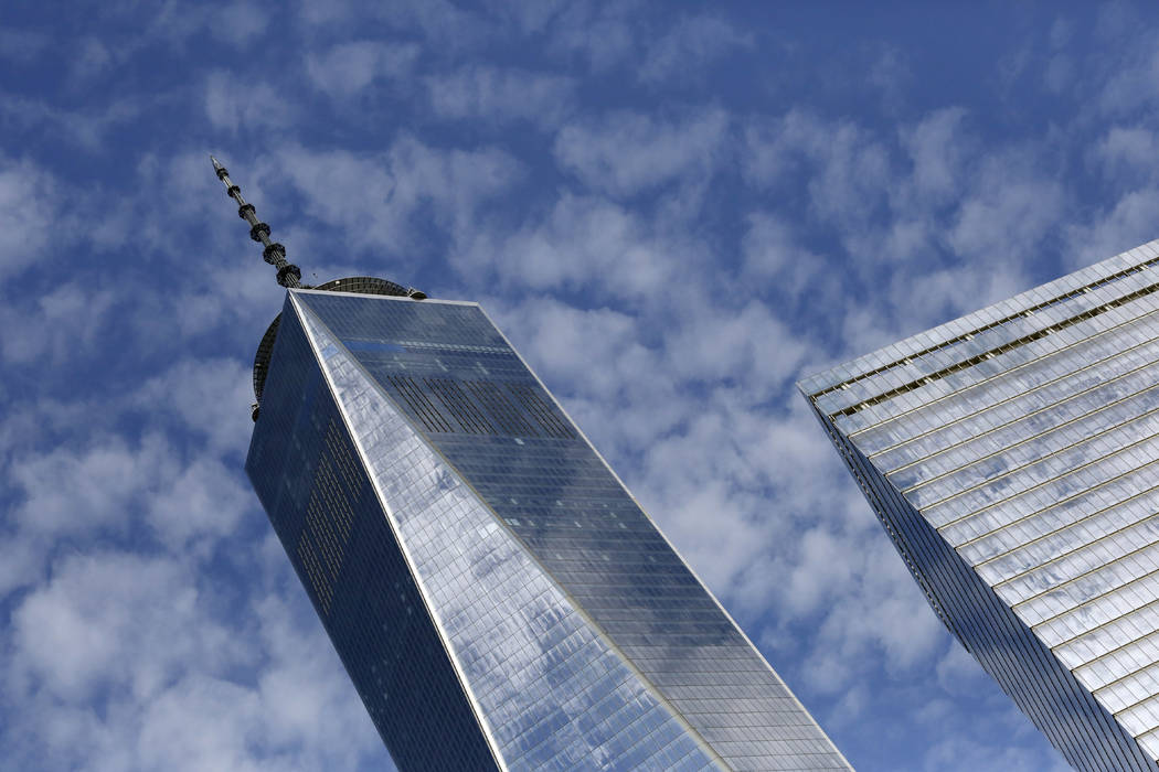 One World Trade Center, left, and 7 World Trade Center, in New York are shown on Tuesday, Aug. 16, 2016. (AP Photo/Mark Lennihan, File)