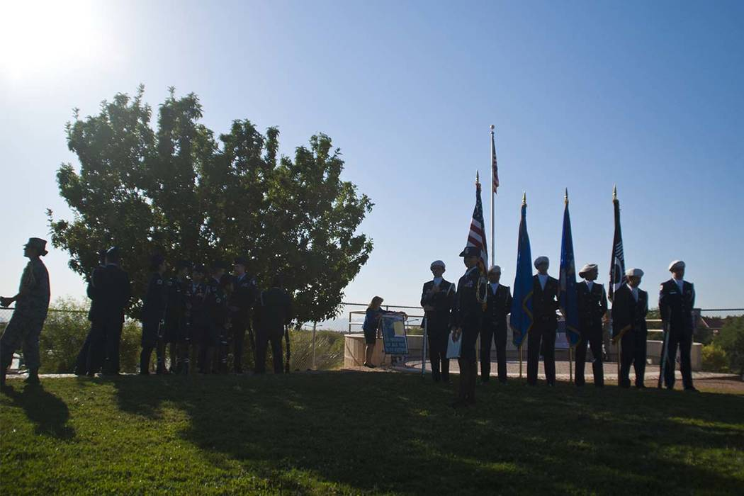 Members of the Palo Verde High School Air Force JROTC honor the victims of the 9/11 attacks with a flag rededication ceremony at the Barbara Edwards Memorial on campus in Las Vegas on Friday, Sept ...