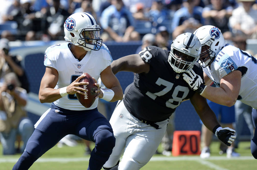 Tennessee Titans quarterback Marcus Mariota (8) is pressured by Oakland Raiders defensive tackle Justin Ellis (78) in the first half of an NFL football game Sunday, Sept. 10, 2017, in Nashville, T ...