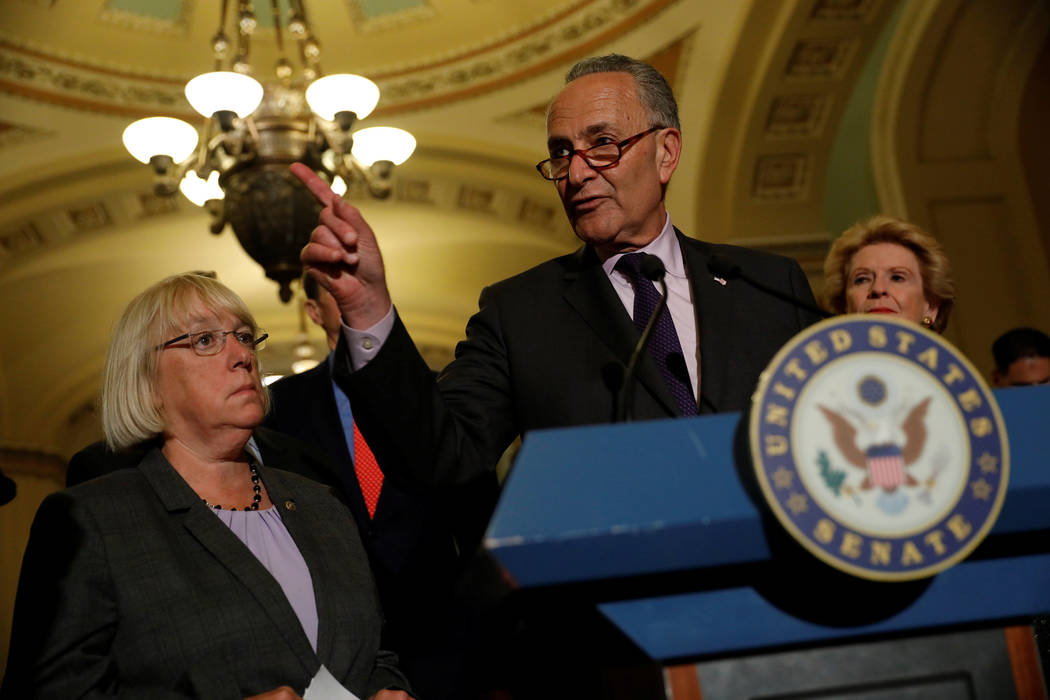 Senate Minority Leader Chuck Schumer, accompanied by Senator Patty Murray (D-WA) and Senator Debbie Stabenow (D-MI), speaks with reporters following the successful vote to open debate on a health  ...