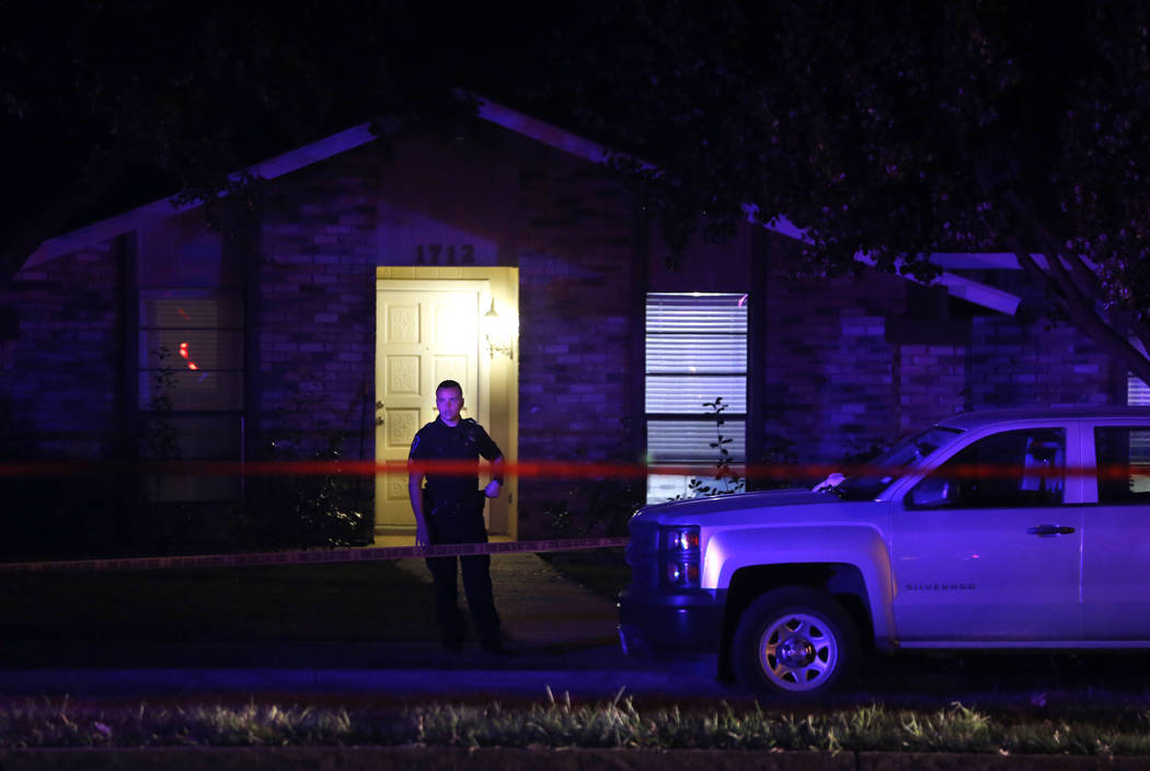 A police officer works the scene of a shooting at a home in Plano, north of Dallas, Texas, Sunday night, Sept. 10, 2017. Authorities in North Texas say several people are dead, including the suspe ...