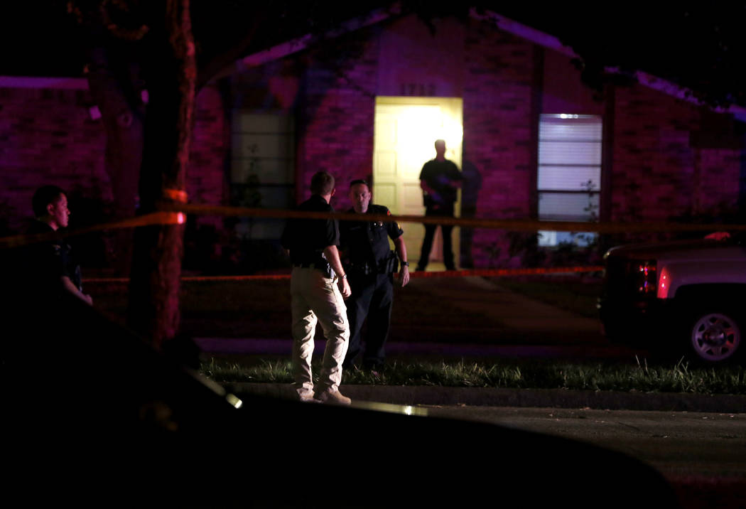 Police officers work the scene of a shooting at a home in Plano, north of Dallas, Texas, Sunday night, Sept. 10, 2017. Authorities in North Texas say several people are dead, including the suspect ...