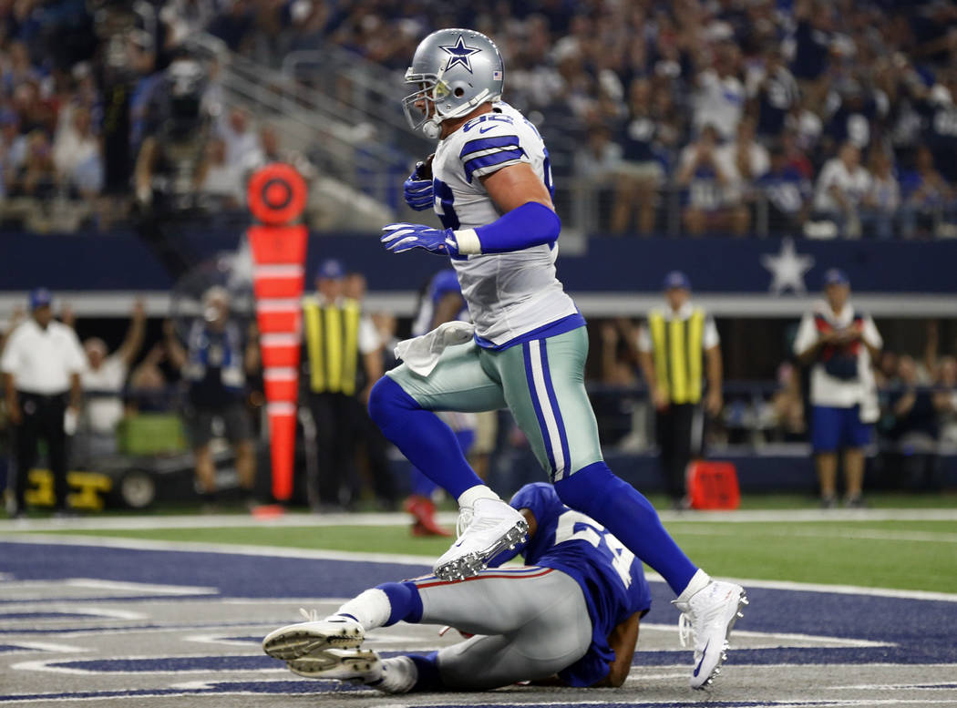 Dallas Cowboys tight end Jason Witten (82) catches a touchdown pass in front of New York Giants cornerback Eli Apple (24) in the first half of an NFL football game, Sunday, Sept. 10, 2017, in Arli ...
