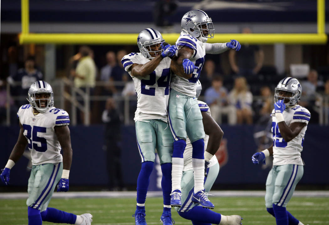 Dallas Cowboys cornerback Nolan Carroll II (24) and cornerback Anthony Brown (30) celebrate an interception by Brown in the second half of an NFL football game against the New York Giants on Sunda ...