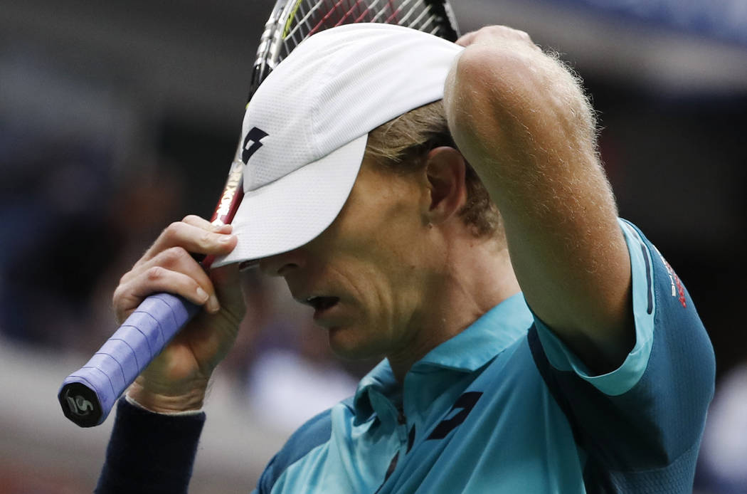 Kevin Anderson, of South Africa, adjusts his cap between serves from Rafael Nadal, of Spain, during the men's singles final of the U.S. Open tennis tournament, Sunday, Sept. 10, 2017, in New York. ...