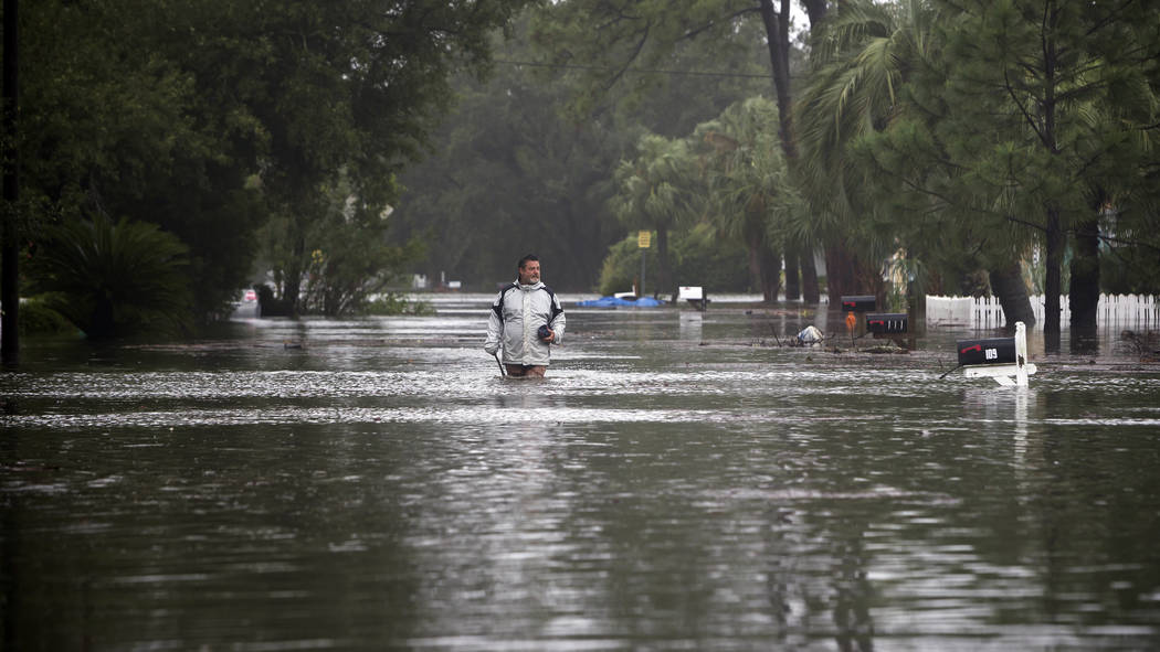 Joey Spalding walks back to his truck down the street where he lives, Monday, Sept. 11, 2017, on Tybee Island, Ga. Spalding just finished repairing his house from nine inches of water after Hurric ...