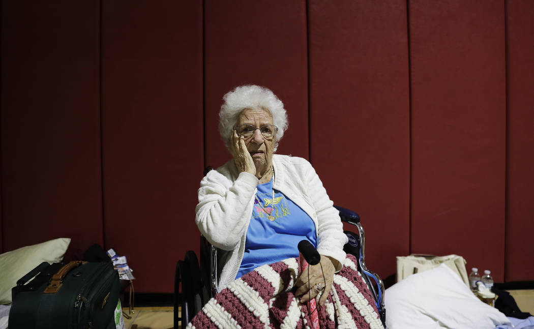 "Mary Della Ratta, 94, sits in shelter after evacuating her home with the help of police last night ahead of Hurricane Irma in Naples, Fla., Sunday, Sept. 10, 2017. ""I'm afraid of what's g ..."