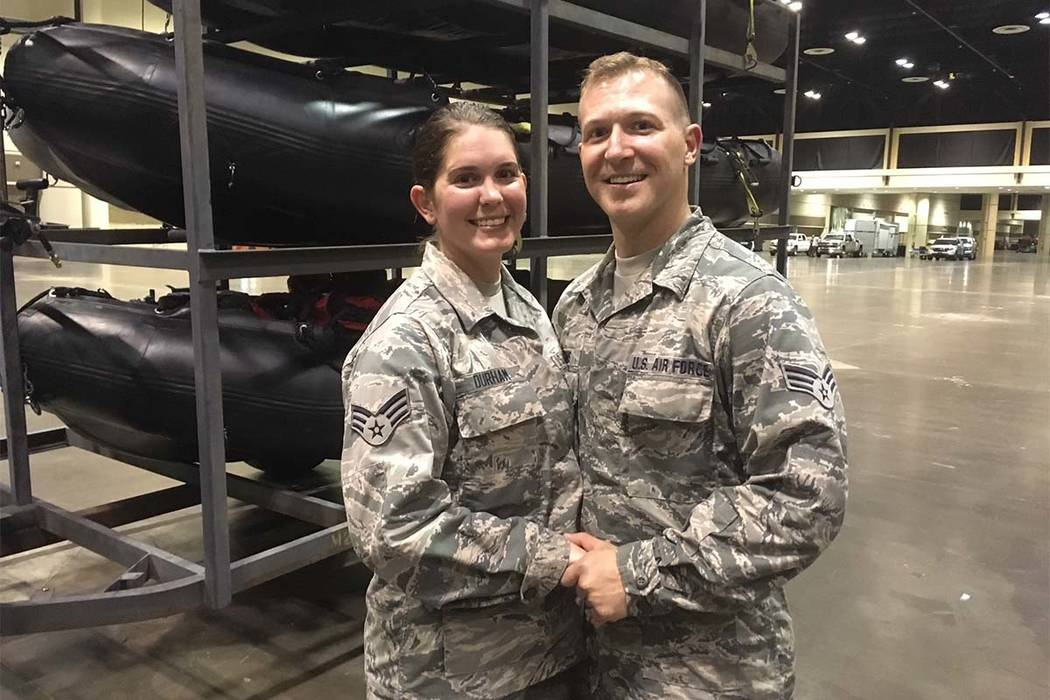 Lauren Durham, left, and Michael Davis, both members of the Air National Guard, pose at the Orange County Convention Center in Orlando, Fla., on Sunday, Sept. 10, 2017. The couple were planning to ...