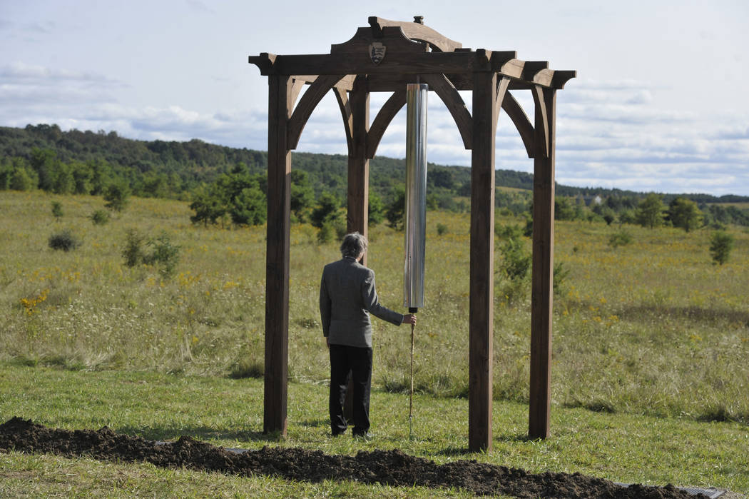 "Paul Murdoch, Architect, Flight 93 National Memorial listens to the ""Soundbraking"" after ringing the C-4 chime at the future site of the Tower of Voices Flight 93 National Memori ..."