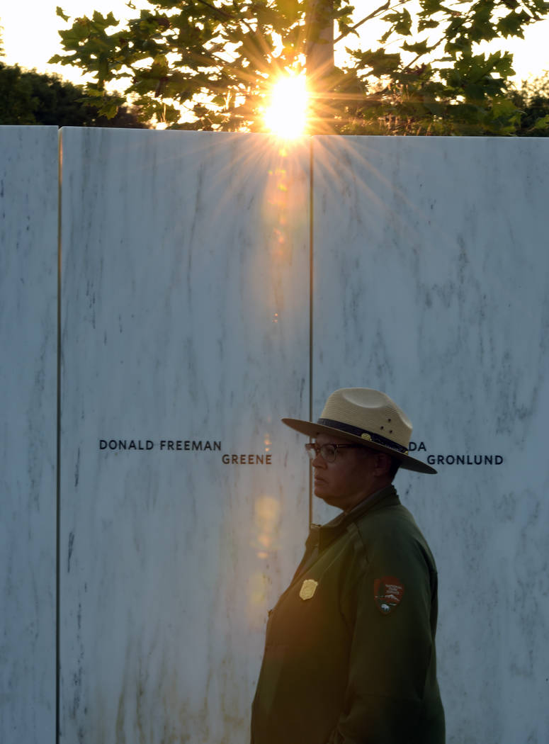 A park ranger stands in front of the Wall of Names at the United Flight 93 National Memorial in Shanksville, Pa., Saturday, Sept. 10, 2017. (AP Photo/Fred Vuich)