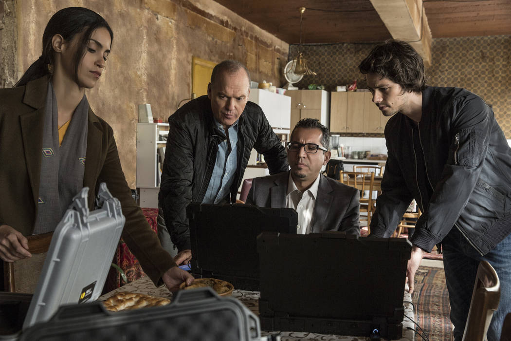 """Shiva Negar, Michael Keaton, Neg Adamson and Dylan O'Brien in """"American Assassin"""" to be released by CBS Films and Lionsgate. Christian Black"""