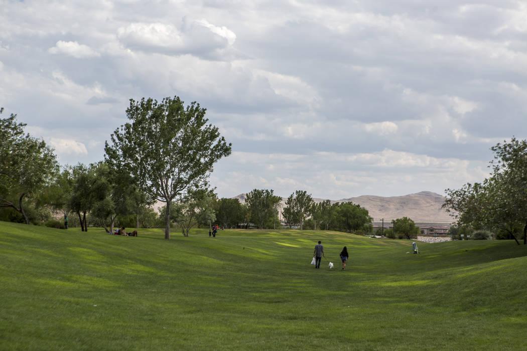 Visitors walk around Exploration Peak Park in southwest Las Vegas. (Patrick Connolly/Las Vegas Review-Journal) @PConnPie