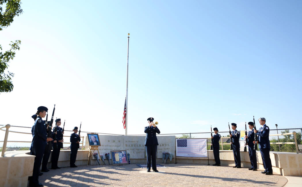 A new flag is placed on the Barbara Edwards Memorial during Palo Verde High School's Air Force JROTC's  annual rededication ceremony in remembrance of the victims, including the school's foreign l ...