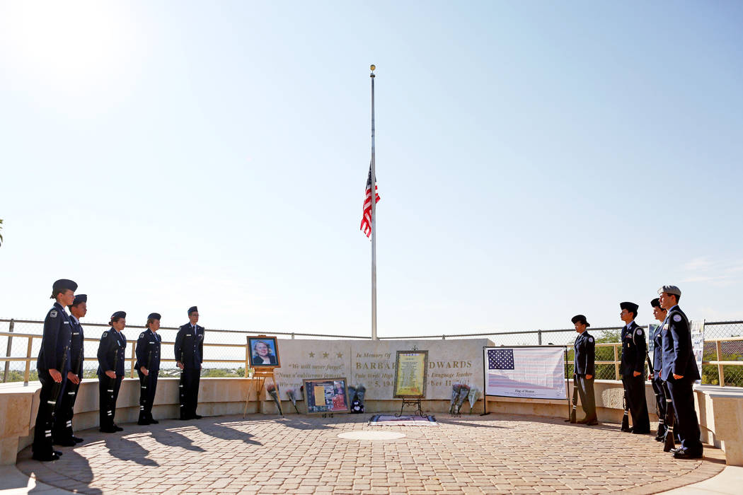 Palo Verde high school's Air Force JROTC's  stand after the new flag has been raised during the annual rededication ceremony in remembrance of the victims, including the school's foreign languages ...