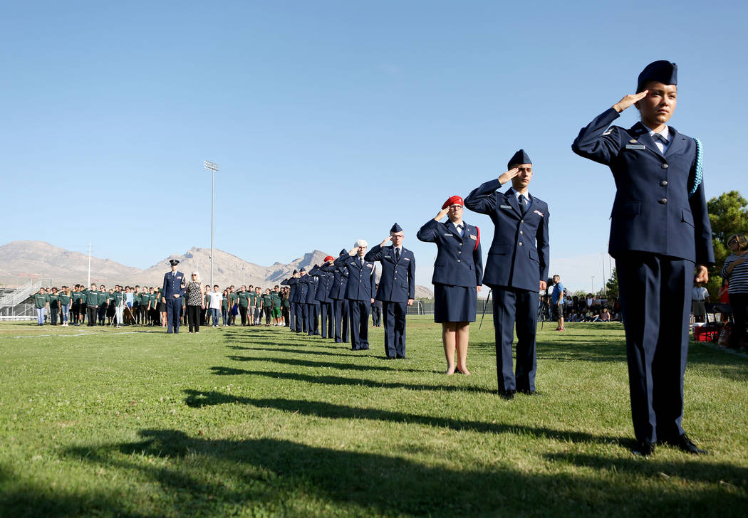 Members of Palo Verde high school's Air Force JROTC's salute while Gail Fahy, previous Palo Verde high school's foreign language chair, is honored during the annual rededication ceremony in rememb ...