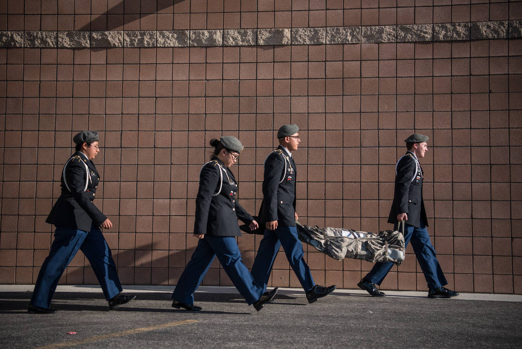 The Cheyenne High School Color Guard leaves the schoolyard with a bag containing the flags at Joseph M. Neal STEAM Academy on Monday, Sep. 11, 2017, in Las Vegas. Morgan Lieberman Las Vegas Review ...