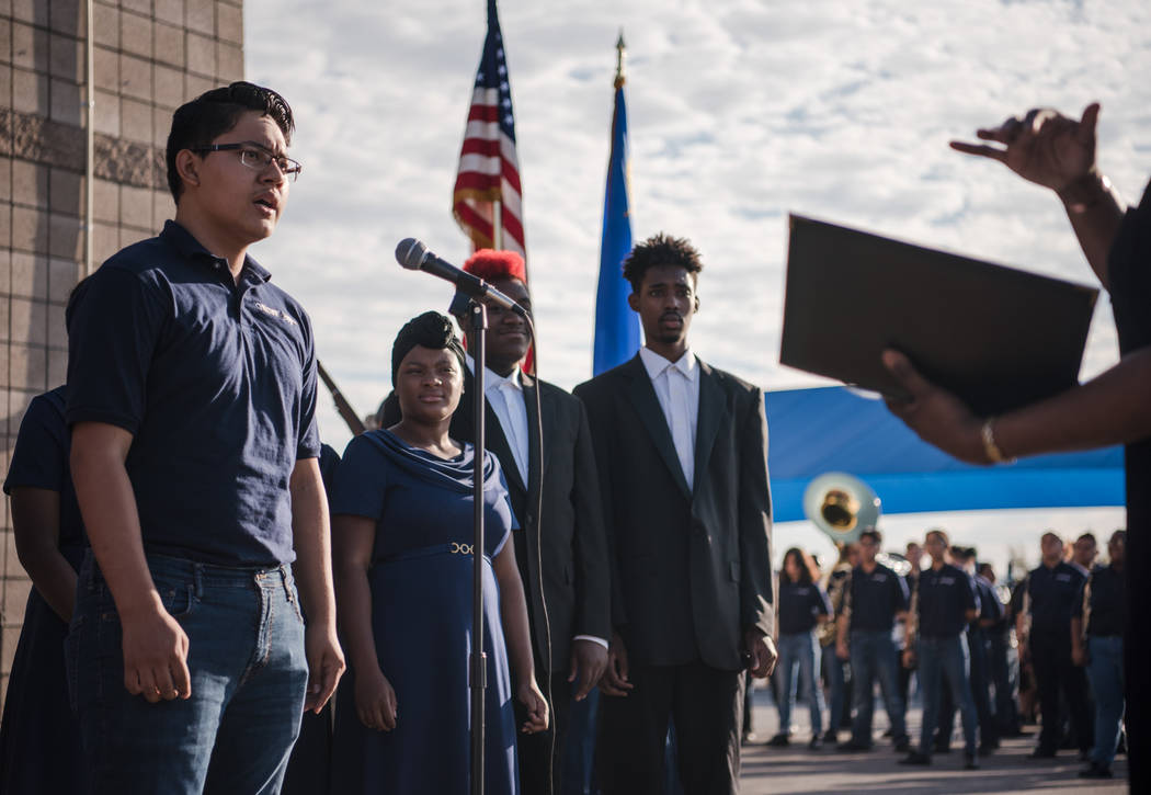 Eduardo Barba of the Cheyenne High School Marching Band begins the ceremony with a song about freedom at Joseph M. Neal STEAM Academy on Monday, Sep. 11, 2017, in Las Vegas. Morgan Lieberman Las V ...