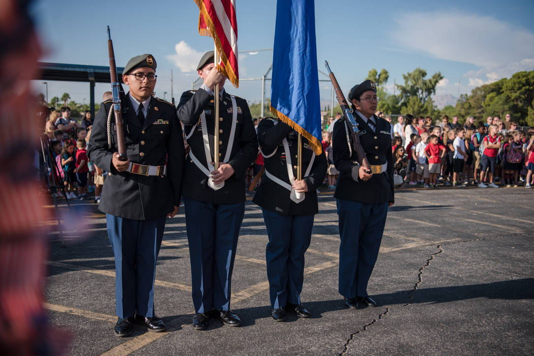 The Cheyenne High School Color Guard waits to begin the changing of the colors at Joseph M. Neal STEAM Academy on Monday, Sep. 11, 2017, in Las Vegas. Morgan Lieberman Las Vegas Review-Journal