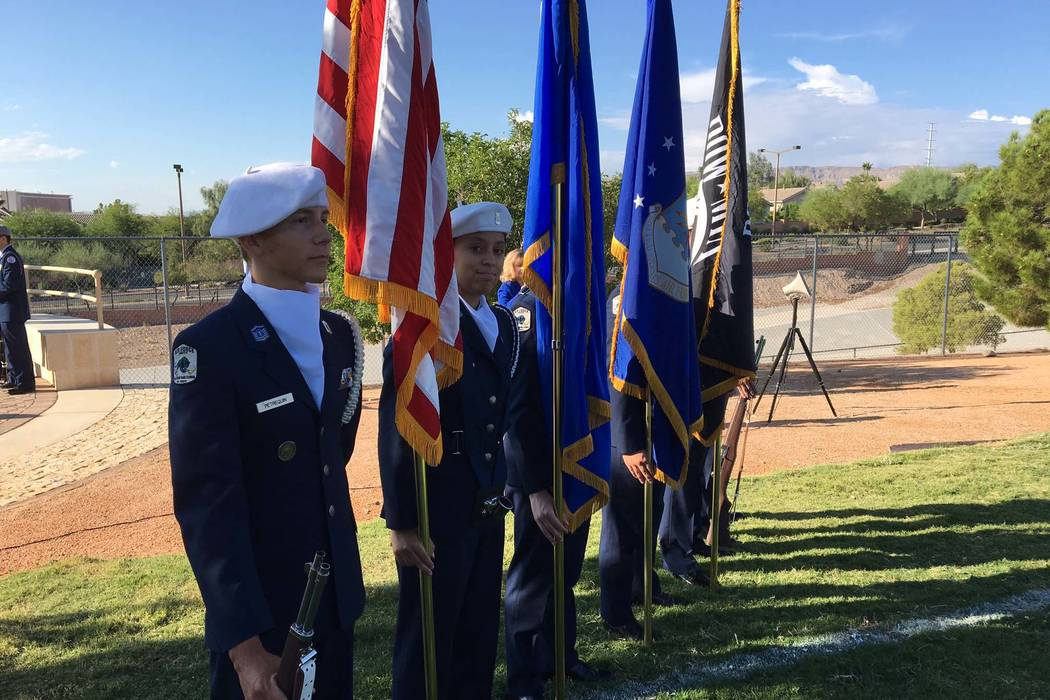 Members of the Palo Verde High School Air Force JROTC prepare for a ceremony to honor victims of the 9/11 attack at the Barbara Edwards Memorial on campus in Las Vegas, Sept. 11, 2017. (Michael Qu ...