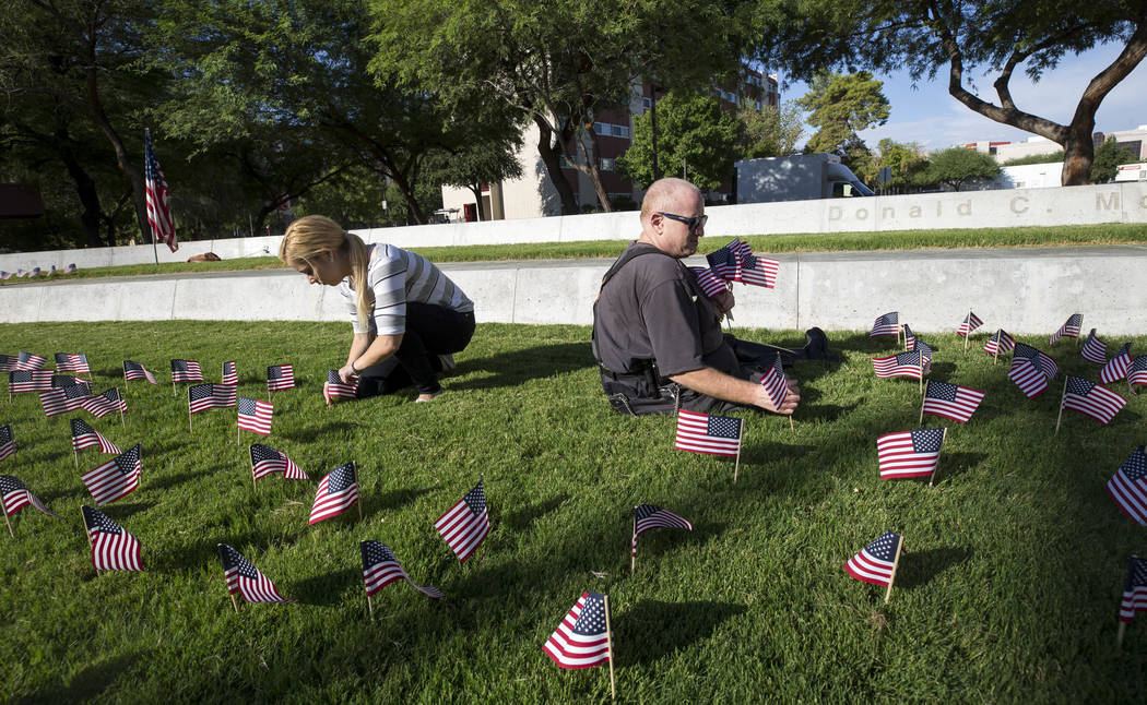 UNLV sophomore Nicole Mirkovic, left, and retired New York City police officer and UNLV alumnus Seth Kimmel ahead of a ceremony in remembrance of the Sept. 11 terrorist attacks on Monday morning,  ...