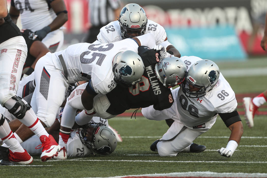 UNLV running back Charles Williams (8) is tackled by the Howard Bison during the first quarter at Sam Boyd Stadium in Las Vegas, Saturday, Sept. 2, 2017. Joel Angel Juarez Las Vegas Review-Journal ...