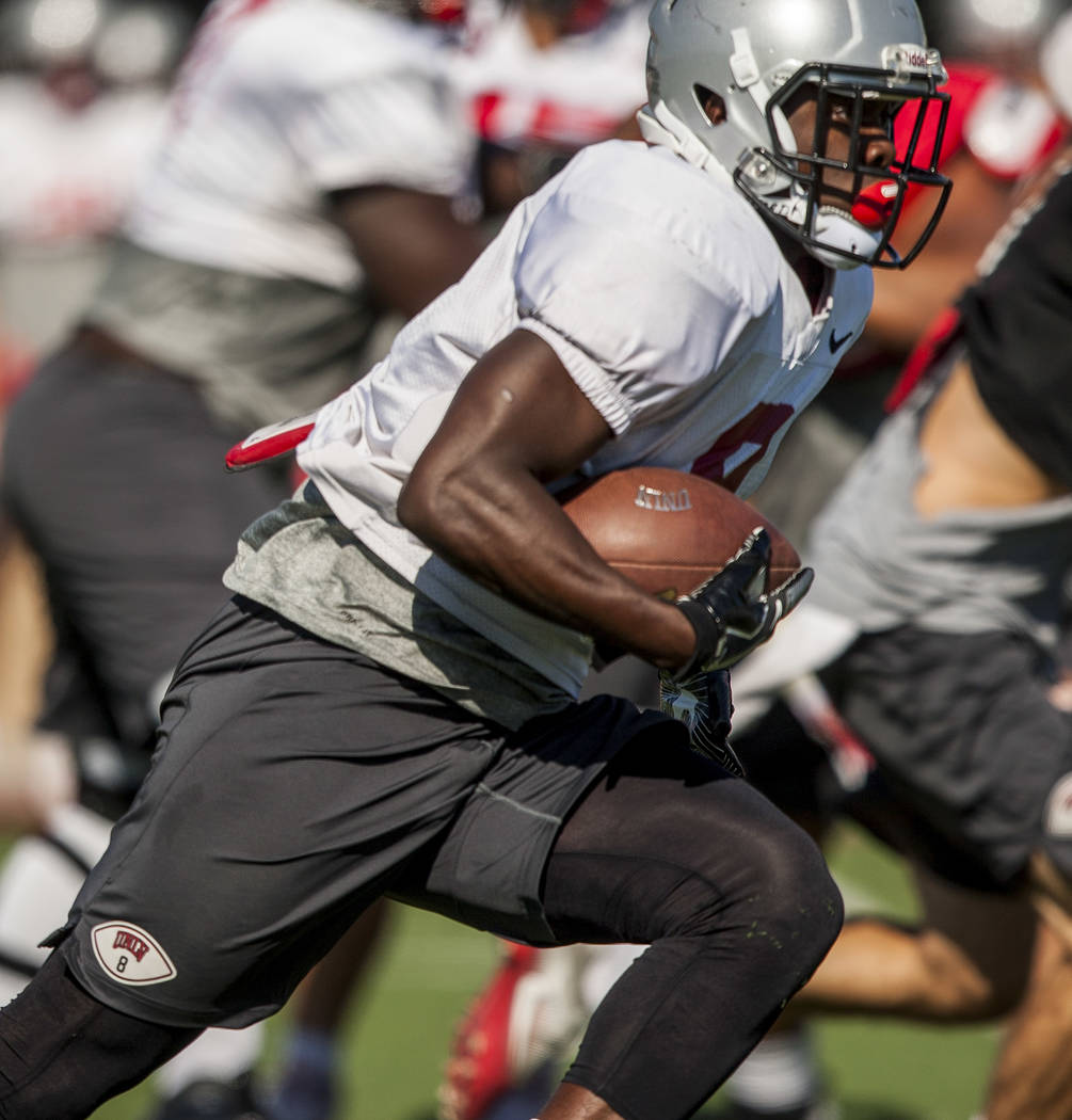 UNLV running back Charles Williams runs the ball during training camp at Rebel Park on Tuesday, Aug. 8, 2017.  Patrick Connolly Las Vegas Review-Journal @PConnPie