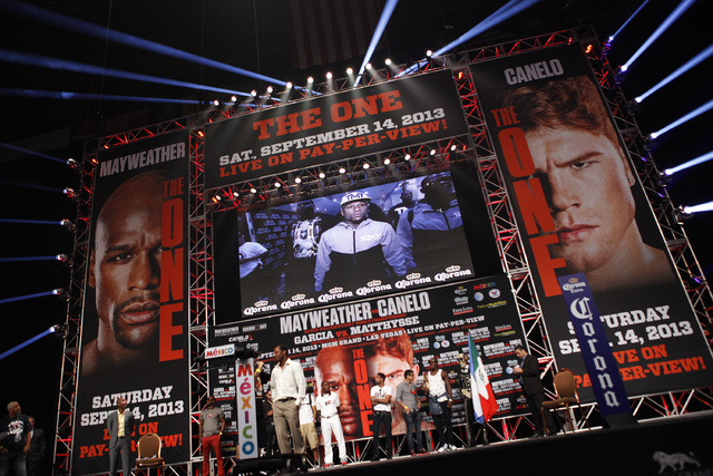 Floyd Mayweather is seen on screen entering a weigh in at the MGM Grand in Las Vegas Friday, Sept. 13, 2013. Mayweather will fight Canelo Alvarez Saturday in a title bout at the MGM Grand.(John Lo ...