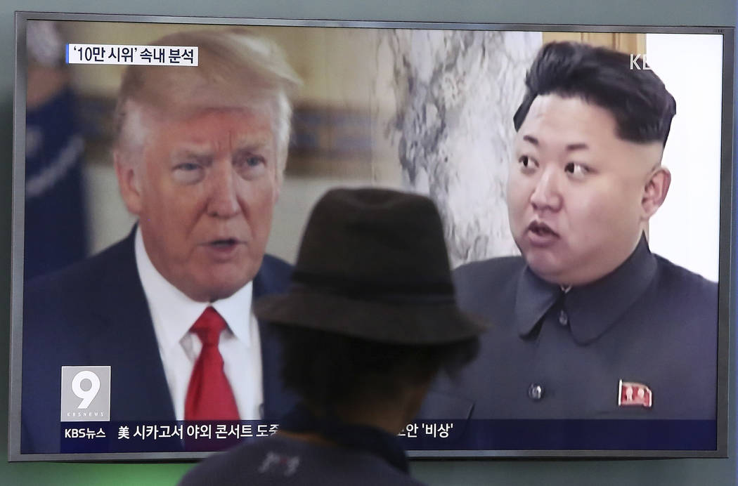 A man watches a television screen showing President Donald Trump and North Korean leader Kim Jong Un during a news program Aug. 10, 2017, at the Seoul Train Station in Seoul, South Korea. North Ko ...