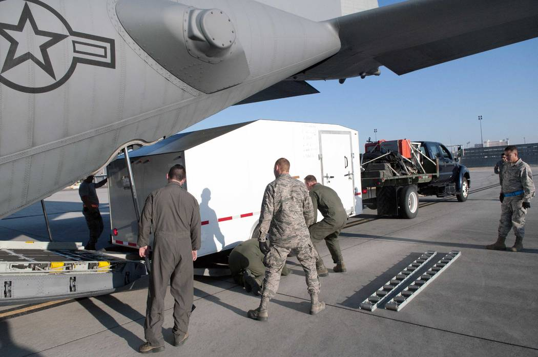 Nevada Air National Guard airmen load the 152nd Airlift Wing's Joint Incident Site Communications Capability system into a C-130 on Sunday. The Air Guard left Monday to assist with Hurricane Irma  ...