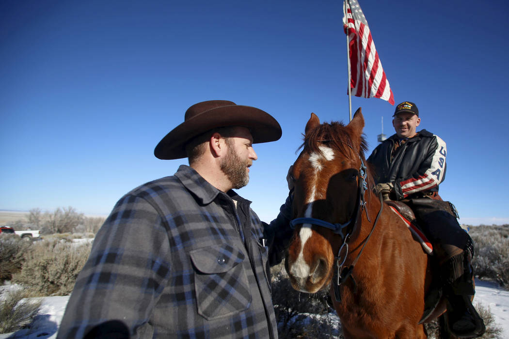 Leader of a group of armed protesters Ammon Bundy, left, greets occupier Duane Ehmer and his horse Hellboy at the Malheur National Wildlife Refuge near Burns, Oregon, January 8, 2016. (Jim Urquhar ...