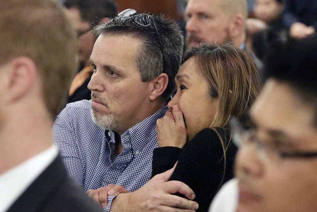 Marcia Fajardo, right, mother of Jaelan Jonson Fajardo who died in a crash caused by a drunk driver, David Fensch, not photographed, comforted by her husband James Tierney as Fensch appears at the ...