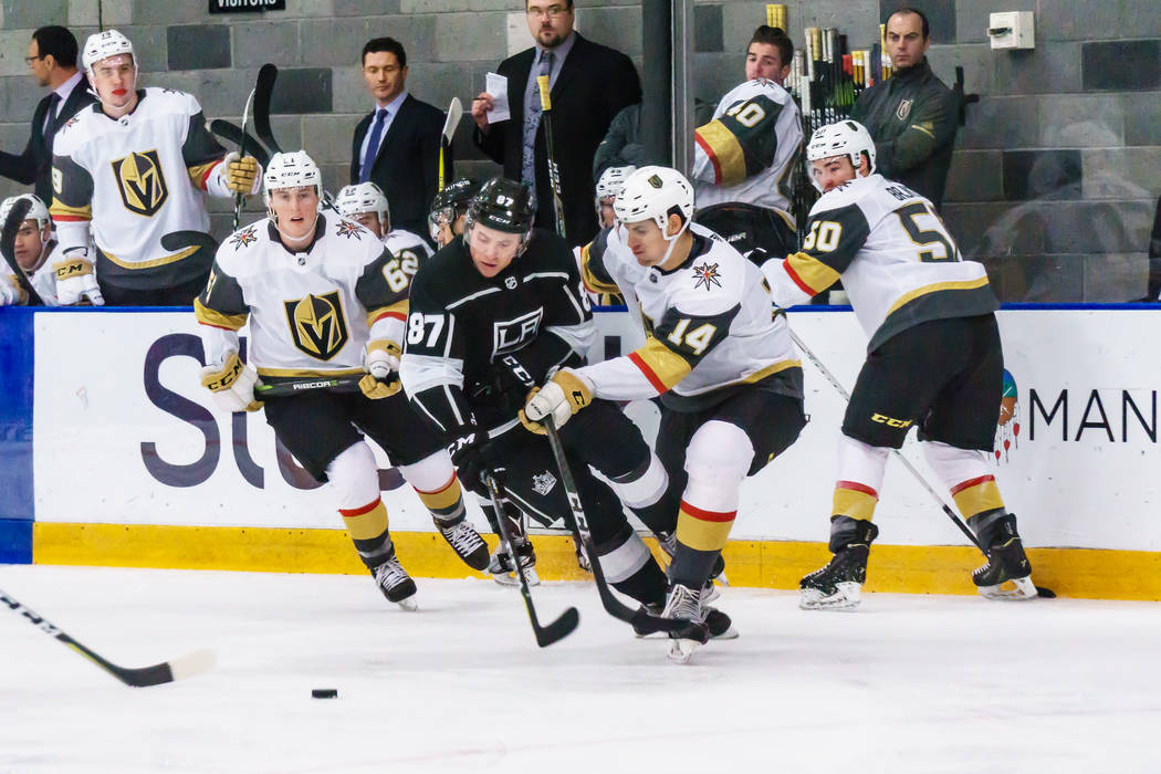 Golden Knights defenseman Nicolas Hague(14) and Los Angles Kings forward Shane Walsh(87) battle for the puck during a rookies' hockey game in El Segundo, Calf., Wednesday, Sept. 13, 2017. The Gold ...