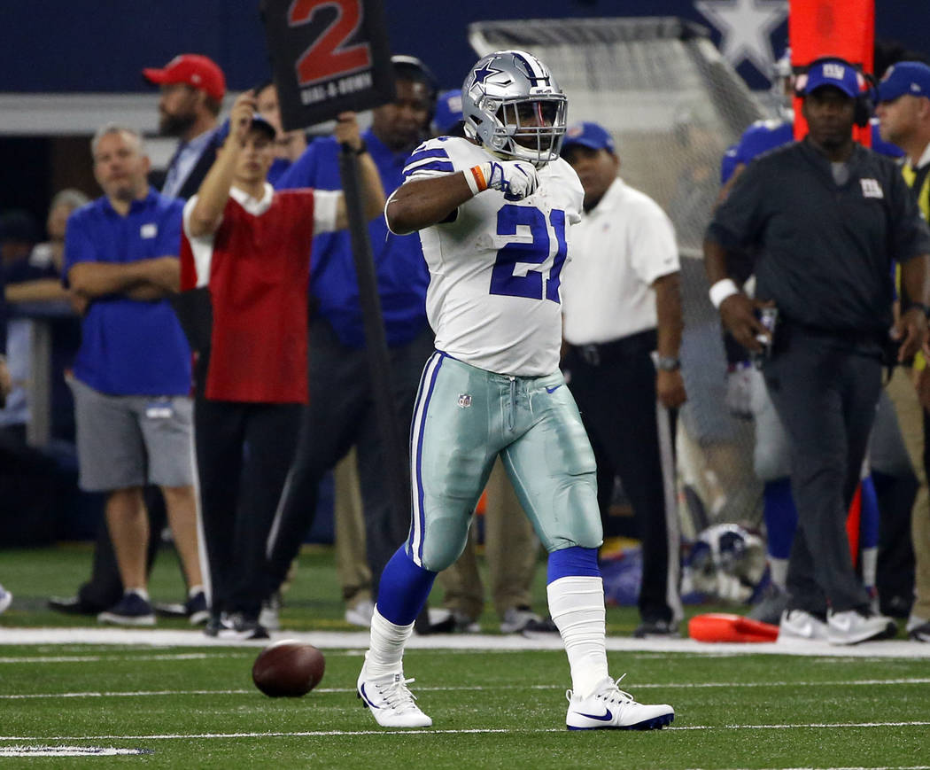 "Dallas Cowboys running back Ezekiel Elliott (21) gestures ""feed zeke"" after a long run in the first half of an NFL football game against the New York Giants on Sunday, Sept. 10,  ..."