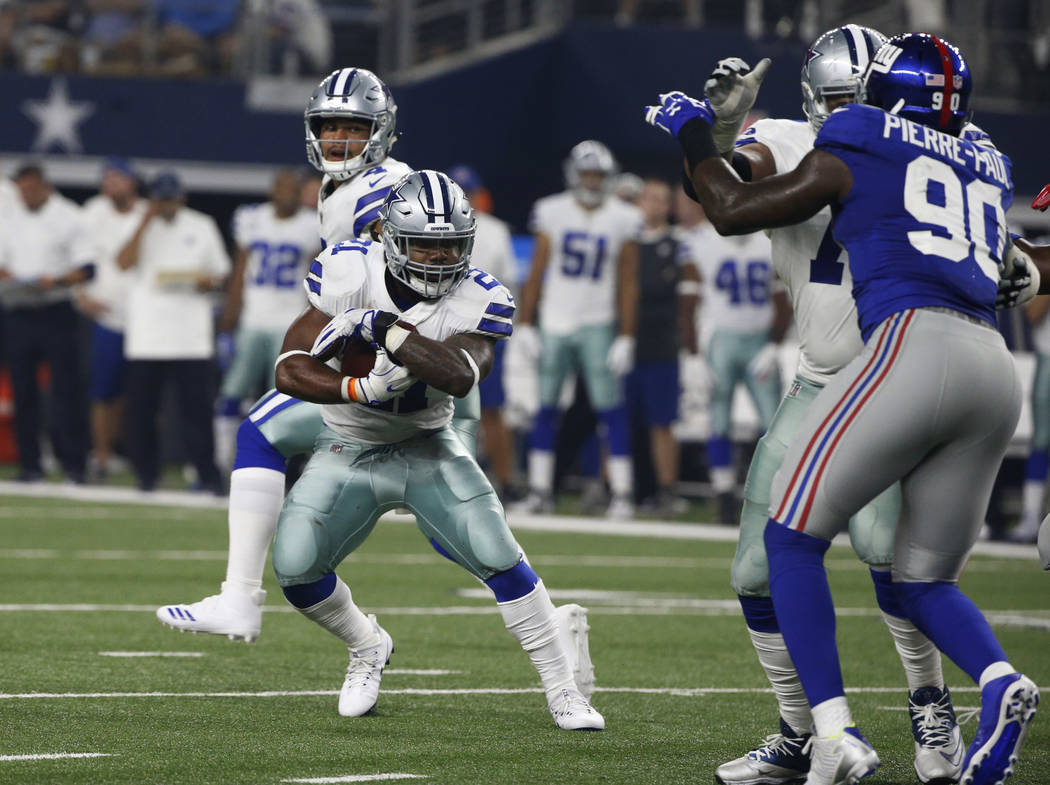 Dallas Cowboys running back Ezekiel Elliott (21) runs against the New York Giants during the first half of an NFL football game, Sunday, Sept. 10, 2017, in Arlington, Texas. (AP Photo/Michael Ains ...