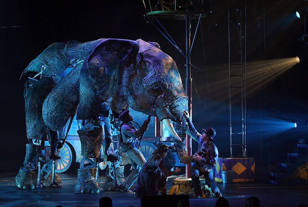 "Puppeteers and cast members perform with an elephant puppet named Queenie during the opening night of ""Circus 1903."" (Ethan Miller/Getty Images for ""Circus 1903"" At Paris Las Vegas)"