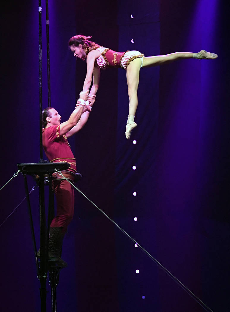 "LAS Andrei Kalesnikau and Anny Laplante of Les Incredibles perform during the opening night of ""Circus 1903."" (Ethan Miller/Getty Images for ""Circus 1903"" At Paris Las Vegas)"