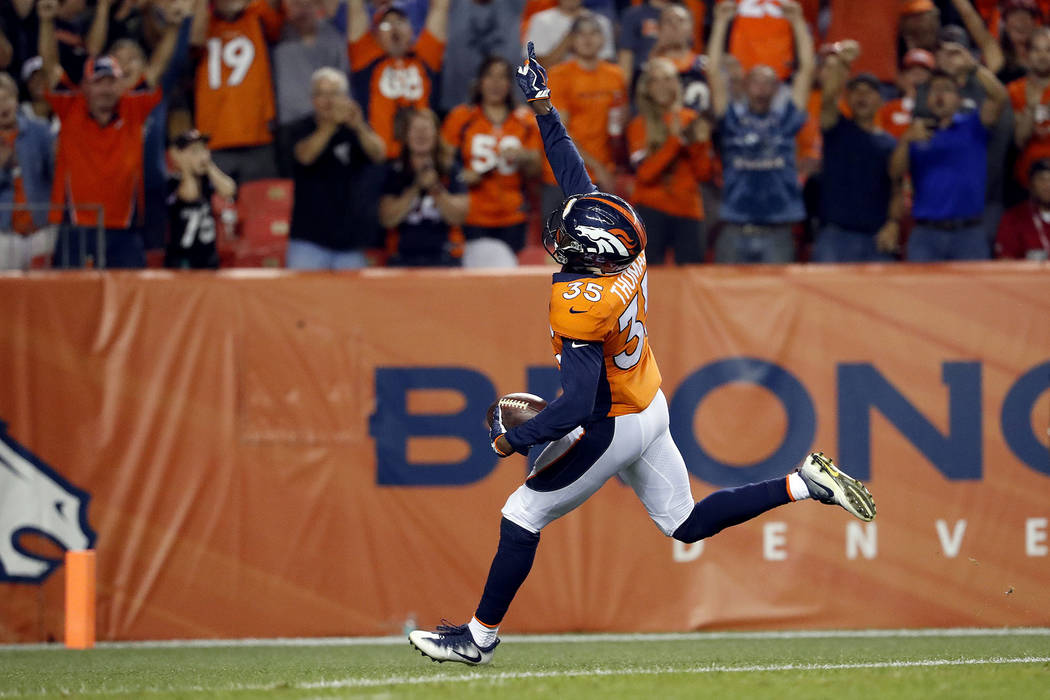 Denver Broncos defensive back Dymonte Thomas (35) celebrates as he scores a touchdown against the Arizona Cardinals during the first half of an NFL preseason football game, Thursday, Aug. 31, 2017 ...