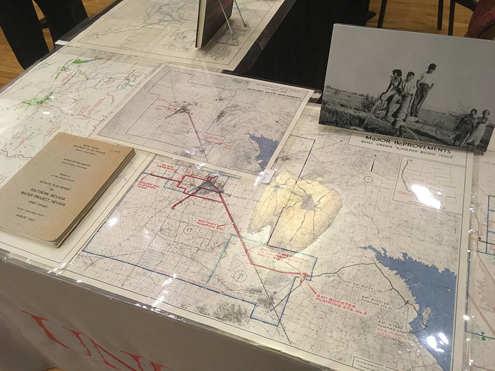 "Maps on tables at the ""Turning the Tide: Water in the Desert"" talk documented flooding-infrastructure improvements made over the years. (Brian Sandford/View) @nweditor"